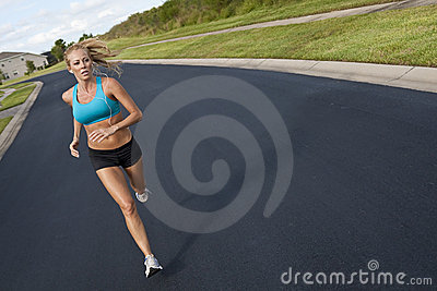 Beautiful Woman Running & Listening to MP3 Player