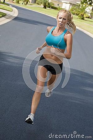 Beautiful Woman Running & Listening to MP3 Player