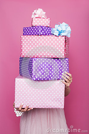 Free Beautiful Woman S Hands Holding A Colorful Big And Small Gift Boxes With Ribbon. Soft Colors. Christmas, Birthday, Valentine Day Royalty Free Stock Photo - 46974235