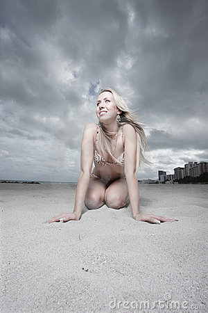 Beautiful woman on the sand
