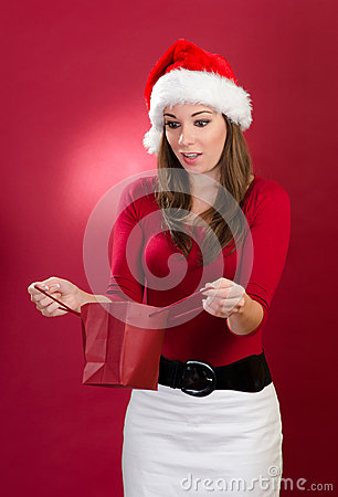 Beautiful woman with santa hat suprised