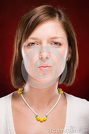 Beautiful woman sending kiss on red