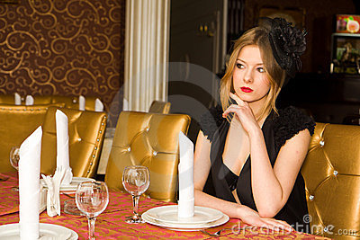 Beautiful woman at served table