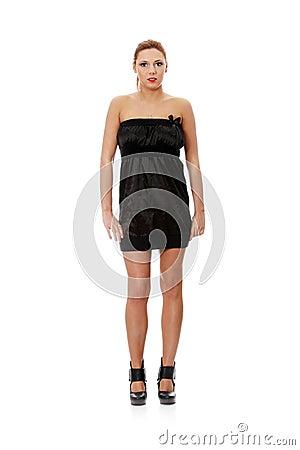 Beautiful woman in sexy elegant dress