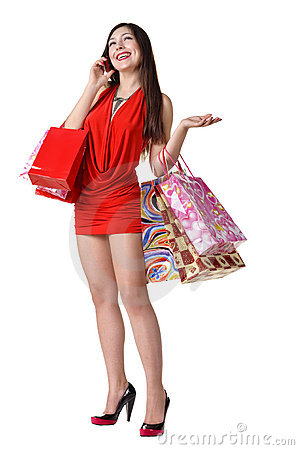 Beautiful woman with shopping bags and phone