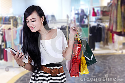 Beautiful woman at shopping center