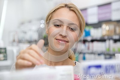 Beautiful woman shopping for medicine Stock Photo