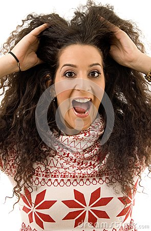 Beautiful woman shouting and holding her hair