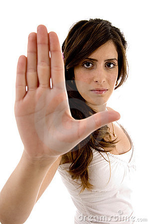 Beautiful woman showing stopping hand gesture