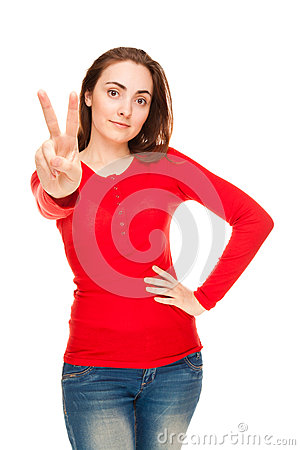 Beautiful woman showing victory sign or peace