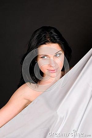 Beautiful woman with silvery silk