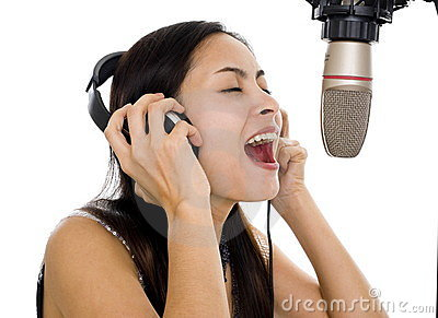 Beautiful woman singing in studio