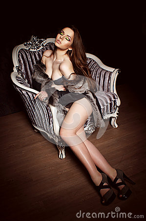 Beautiful woman sit in armchair