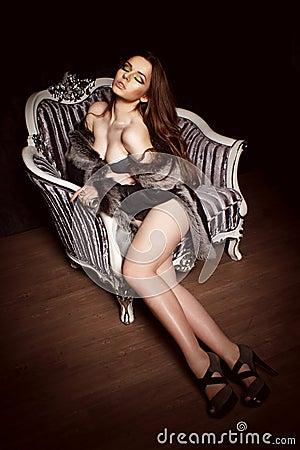 Beautiful woman sit in armchair