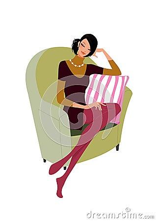 Beautiful woman sit on a sofa