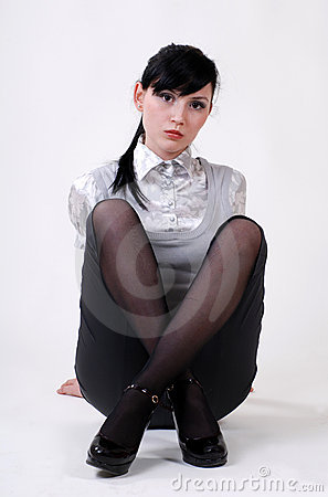 Beautiful woman sits cross-legged