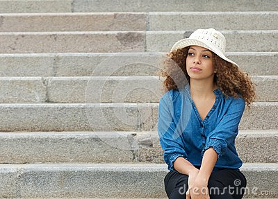 Beautiful woman sitting alone on stairs