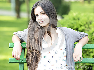 Beautiful woman sitting on bench