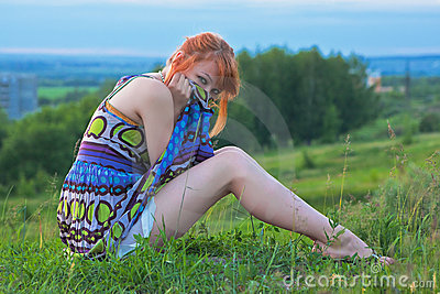 Beautiful woman sitting on the ground