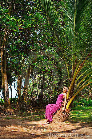 Beautiful woman sitting on the palm
