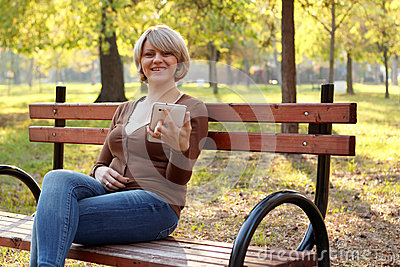 Beautiful woman sitting in park
