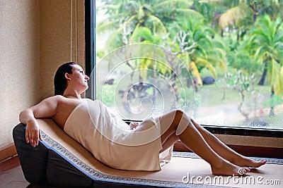 Beautiful woman sitting by the window