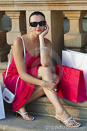 Free Beautiful Woman Sitting With Shopping Bags Stock Images - 13161254