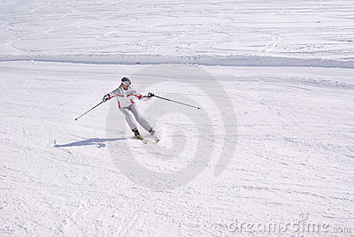 Beautiful woman skiing from downhill