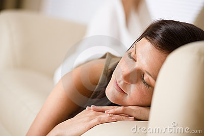 Beautiful woman sleeping on sofa