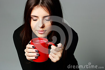 Beautiful woman smelling the aroma of coffee