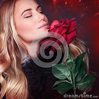 Free Beautiful Woman Smelling Rose Stock Photo - 49275520