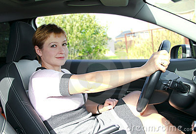 Beautiful woman with smiling behind the wheel