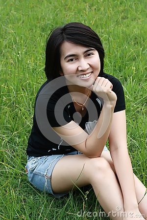 Beautiful  woman smiling in the park