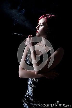 Beautiful woman smokes
