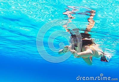Beautiful woman snorkeling in Red Sea