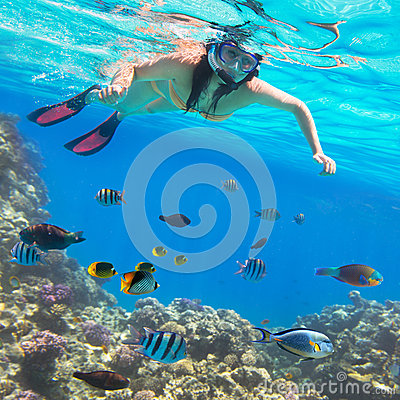 Beautiful woman snorkeling in Red Sea