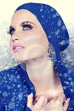 Beautiful woman in snow