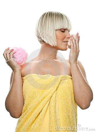 Beautiful woman with soap and sponge