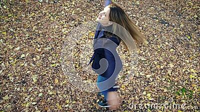 beautiful woman spinning fallen leaves autumn park slow motion k fps girl coat walking city 130808894 - Seeking Arrangements - Sugar Daddy Frauds Using Women of all ages For Money