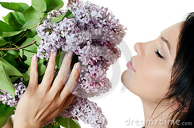 Beautiful woman with spring flowers of a lilac
