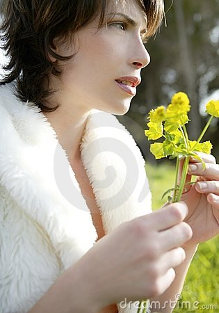 Beautiful woman in a spring landscape