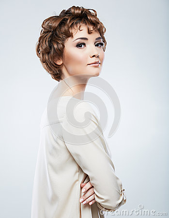 Beautiful woman standing against studio background