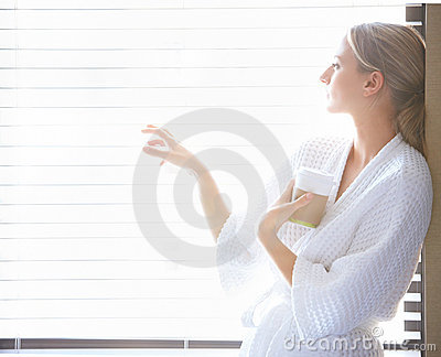 Beautiful woman standing against a window