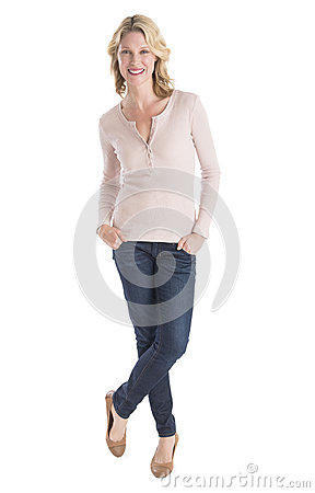 Free Beautiful Woman Standing Hands In Pockets Over White Background Royalty Free Stock Photo - 32430045