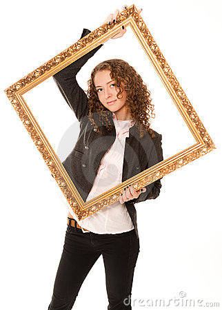 Beautiful woman standing and holding gold frame