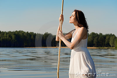 Beautiful woman is standing in the lake.