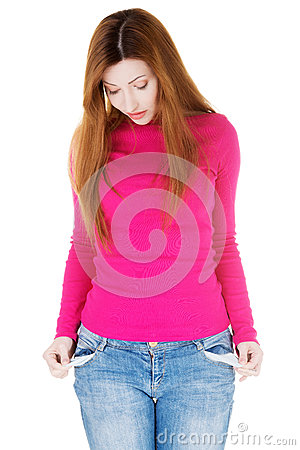 Beautiful woman standing and showing her empty pockets.