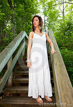 Beautiful Woman Standing on Wooden Steps