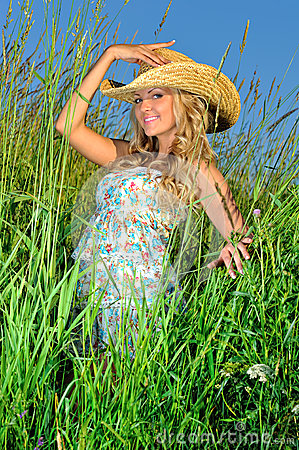 Beautiful woman in straw hat on the nature.