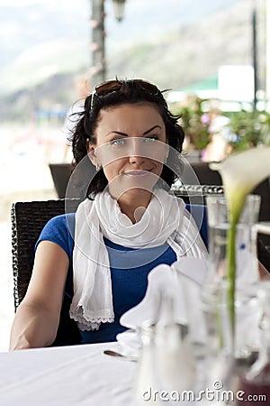 Beautiful woman in street cafe